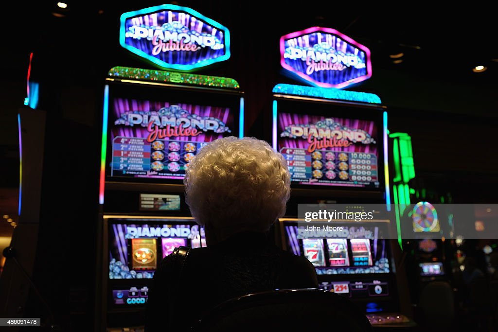 An elderly woman plays slot machines in a casino on the Atlantic City Boardwalk on August 29 in Atlantic City New Jersey After new casinos opened in...