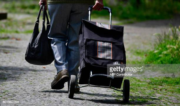 An elderly woman pulls a shopping trolley in Berlin on June 27 2017 According to a study of the Bertelsmann foundation published on June 26 people...