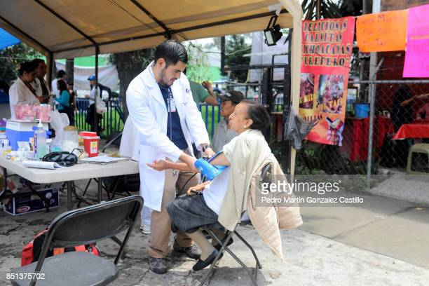 An elderly woman receives medical attention two days after the magnitude 71 earthquake jolted central Mexico killing more than 250 hundred people...