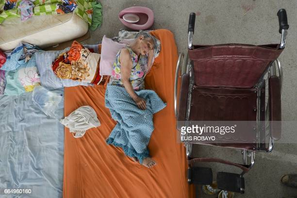 An elderly woman rests at a shelter for victims of the mudslides caused by heavy rains in Mocoa Putumayo department southern Colombia on April 5 2017...