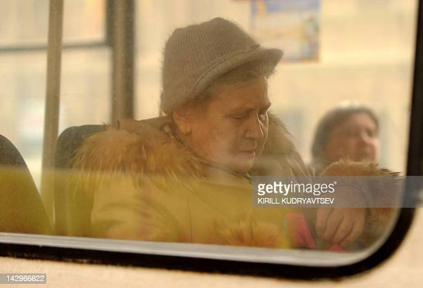 An elderly woman rides in a trolleybus in central Moscow on April 16 2012 AFP PHOTO / KIRILL KUDRYAVTSEV