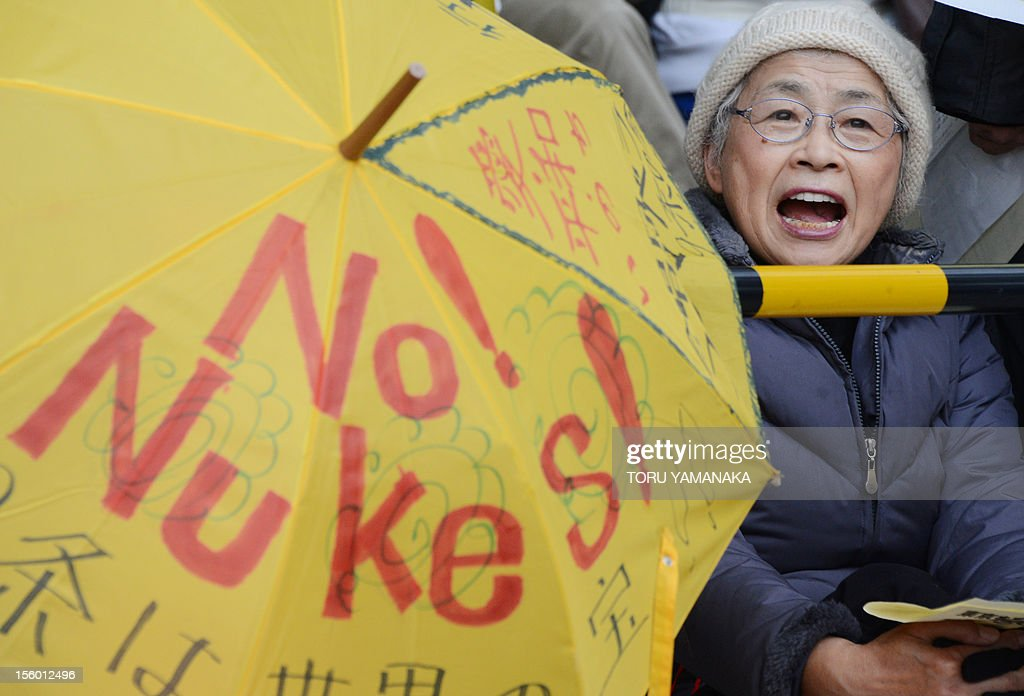 An elderly woman shouts slogans during a rally denoucing nuclear power plants in front of the Diet building in Tokyo on November 11, 2012. Several thousand people took part in the rally. AFP PHOTO/Toru YAMANAKA