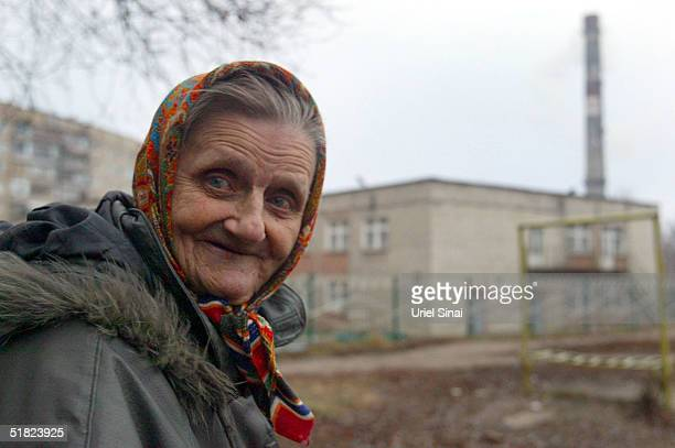 An elderly woman stands outside December 4 2004 in Donetsk Ukraine The city with a population of over 1 million is situated in the south east of the...