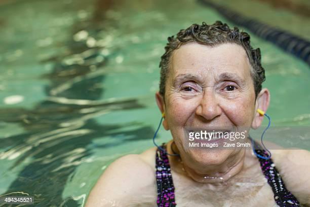 An elderly woman swimmer