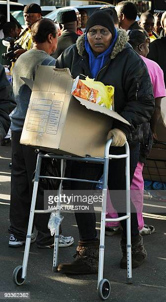 An elderly woman who is one of a group of 10000 lowincome and needy people who lined up to receive free Thanksgiving turkeys and fixings distributed...