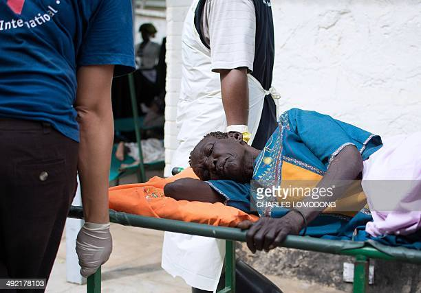 An elderly woman who is treated for dehydration from a suspected case of cholera is carried on a stretcher in Juba's teaching hospital in South Sudan...
