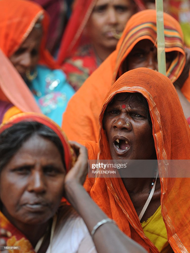 An elderly woman yawns during speeches at a protest attended by activists from the National Federation of Indian Women, Aganwadi Teachers, All India Network of Sex Workers, and farmers, against the Congress-led UPA government as they demand entitlement for universal old age pension in New Delhi on March 6, 2013. More than 100 social organisations from across the country gathered in the capital to form a 'pension parishad', seeking addressal of universal pension for elderly people. AFP PHOTO/RAVEENDRAN