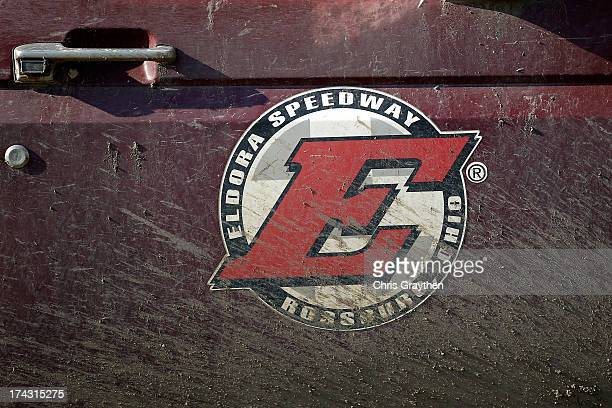 An Eldora Speedway logo is seen covered in mud during practice for the NASCAR Camping World Truck Series inaugural CarCash Mudsummer Classic at...