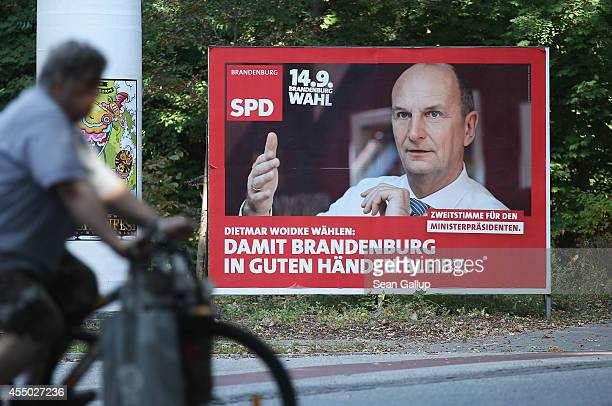 An election campaign billboard of the German Social Democrats that that depicts current Brandenburg Governor Dietmar Woidke stands ahead of upcoming...