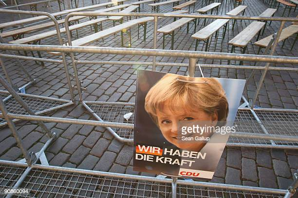 An election campaign poster featuring Chancellor and German Christian Democratic Union Chairwoman Angela Merkel hangs on a railing after an election...