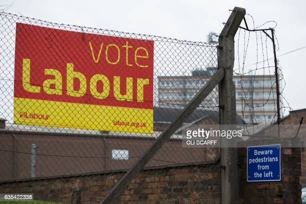 An election campaign poster for the Labour Party is seen in StokeonTrent central England on February 14 2017 The byelection for the seat of...
