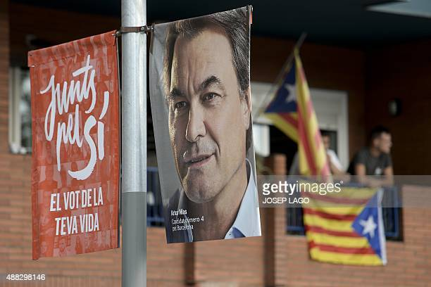 An election campaign poster of former Green European deputy and leader of the list of 'Junts pel Si' Raul Romeva is seen ahead of September 27...