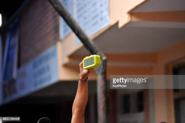 An Election commission official showing clock marks 459 PM to stops voting on 500 PM at Panga Kirtipur Kathmandu on Sunday May 14 2017 The local...