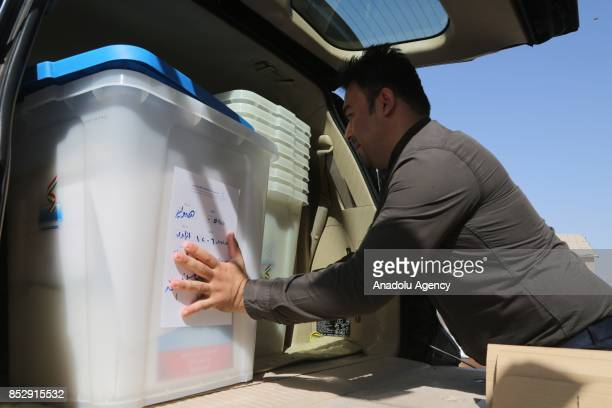 An election committee worker carries ballot boxes to the Barzani Namir high school polling station ahead of the upcoming Kurdish Regional Government...