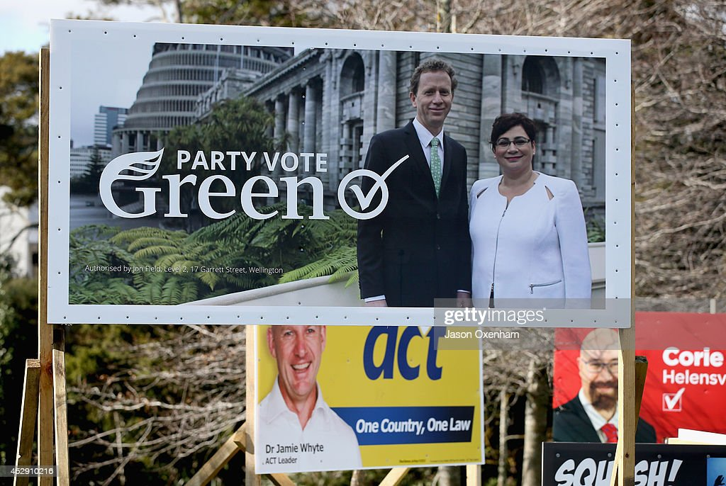 An election hoarding featurng the Green party co-leaders Russel Norman (L) and Metiria Turei in Kumeu on July 30, 2014 in Auckland, New Zealand. New Zealand voters will head to the polls on September 20, 2014.