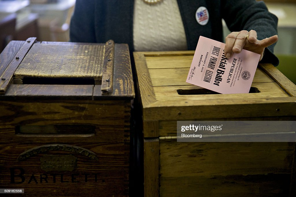 An election moderator places a Republican ballot into a ballot box at the Bartlett town hall during the first-in-the-nation New Hampshire presidential primary in Bartlett, New Hampshire, U.S., on Tuesday, Feb. 9, 2016. Polls suggest that Donald Trump maintains a dominant lead against his Republican rivals in New Hampshire ahead of today's primary. Photographer: Andrew Harrer/Bloomberg via Getty Images