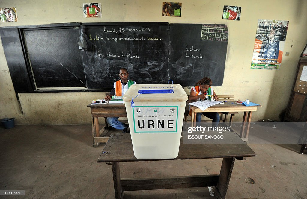 An election officer waits for voters at a polling station on April 21, 2013 in the Abobo suburb of Abidjan. Ivorians voted Sunday in local elections seen as a trial run for a presidential poll in 2015 amid high tensions as the party of former president Laurent Gbagbo boycotted the poll.