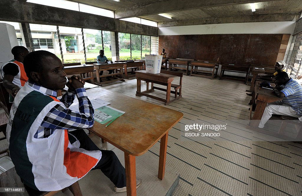 An election officer waits for voters at a polling station on April 21, 2013 in Abidjan. Ivorians voted today in local elections seen as a trial run for a presidential poll in 2015 amid high tensions as the party of former president Laurent Gbagbo boycotted the poll.