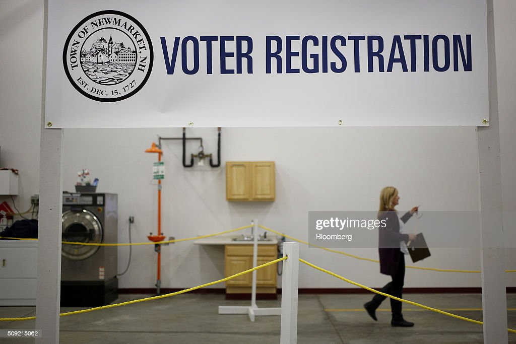 An election official walks through the polling station at the Newmarket Fire Department in Newmarket, New Hampshire, U.S., on Tuesday, Feb. 9, 2016. Voters in New Hampshire took to the polls today in the nation's first primary in the U.S. presidential race. Photographer: Luke Sharrett/Bloomberg via Getty Images