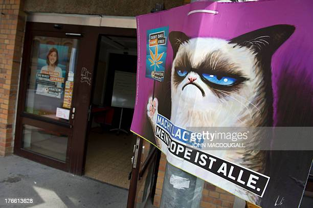 An election poster calling for the legalisation of marijuana and featuring internet meme 'Grumpy Cat' hangs outside the Pirate Party's campaign...