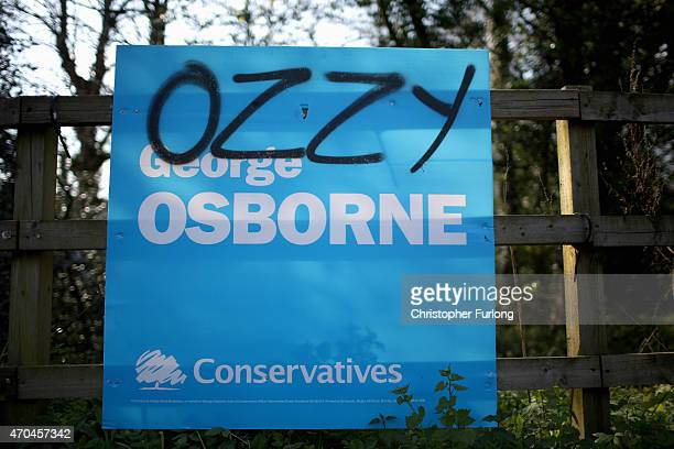 An election poster for Chancellor George Osborne is defaced in his Tatton constituency on April 20 2015 in Knutsford United Kingdom Britain will go...