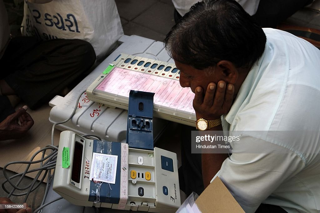 An election staff checking Electronic Voting Machine (EVM) before leaving for their polling booths for the last phase of Assembly poll of Gujarat on December 16, 2012 in Ahmedabad, India.