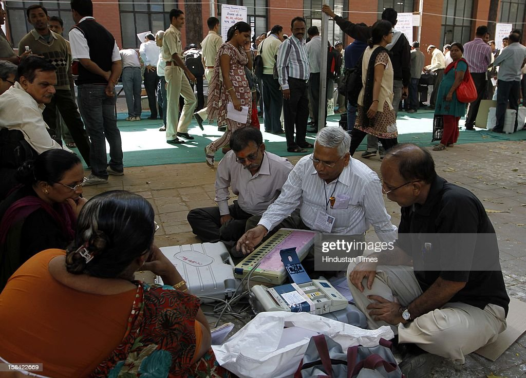 An election staffs checking Electronic Voting Machine (EVM) before leaving for their polling booths for the last phase of Assembly poll of Gujarat on December 16, 2012 in Ahmedabad, India.