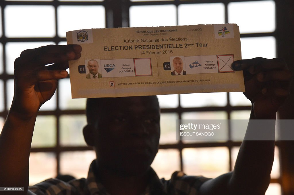 An election worker counts votes after polls closed following the second round presidential and legislatives elections in Bangui, on February 14, 2016, as people go to the polls to take part in the country's delayed legislative and presidential elections. The Central African Republic holds delayed presidential and parliamentary polls on February 14, with voters desperate to usher in peace after the country's worst sectarian violence since independence in 1960. / AFP / ISSOUF SANOGO