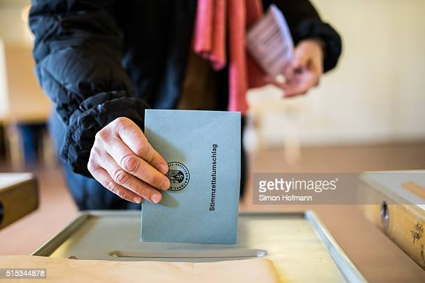 An elector casts his ballot in RhinelandPalatinate state elections on March 13 2016 in Trier Germany State elections taking place today in three...