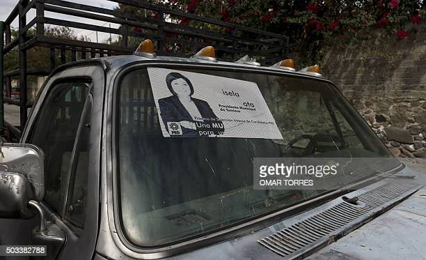 An electoral campaign poster of Gisela Mota the mayor who was gunned down a day after taking office is seen in an old truck outside her house in...