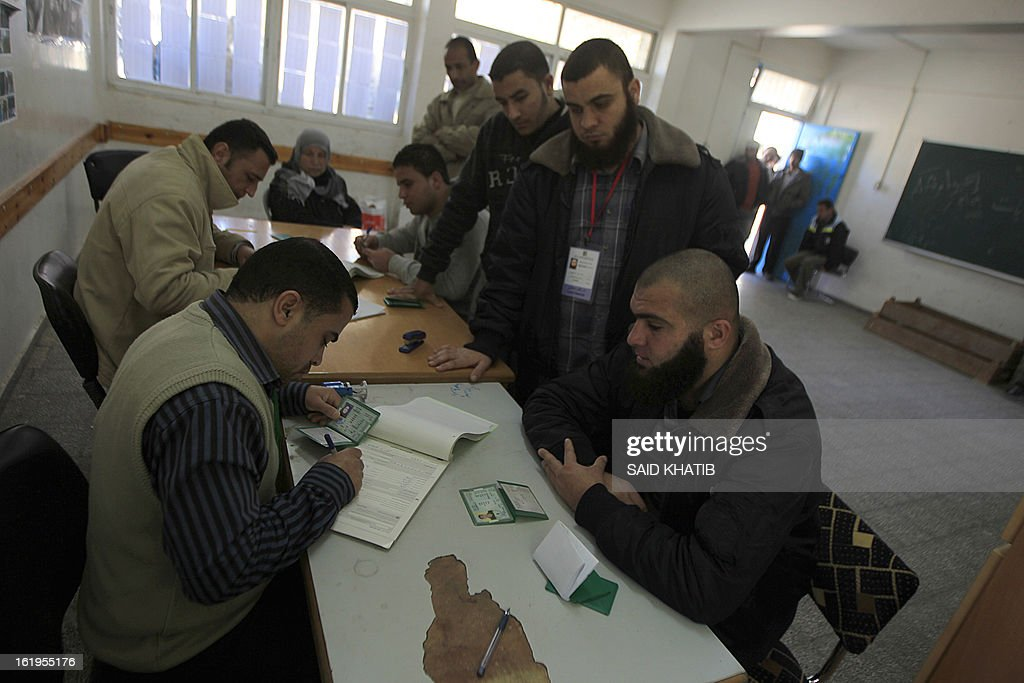 An electoral commission official registers Palestinians at a registration office in Rafah town in the southern Gaza Strip on February 18, 2013. Palestinian electoral officials extended for two additional days the process of updating voter rolls in the West Bank and Gaza After a week of beginning registration in a vital step towards eventual elections.