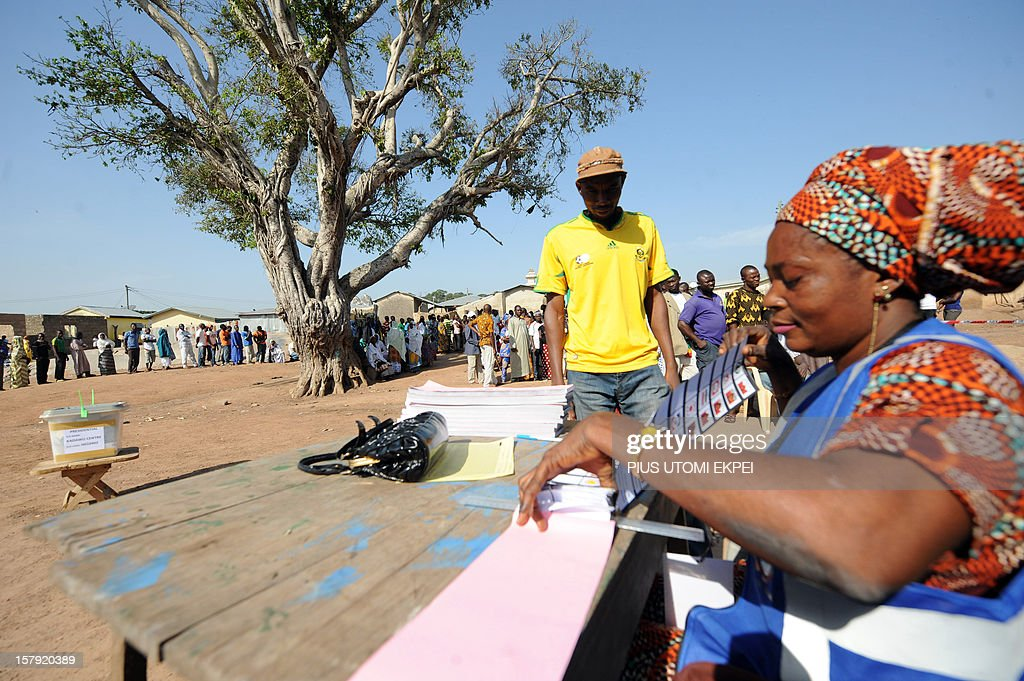 An electoral officer gives ballot papers to a voter upon his arrival at Bole polling station in the northern region on December 7, 2012. Ghana voted in a high-stakes presidential election which is expected to be close, with the emerging country seeking to live up to its promise as a beacon of democracy in turbulent West Africa.