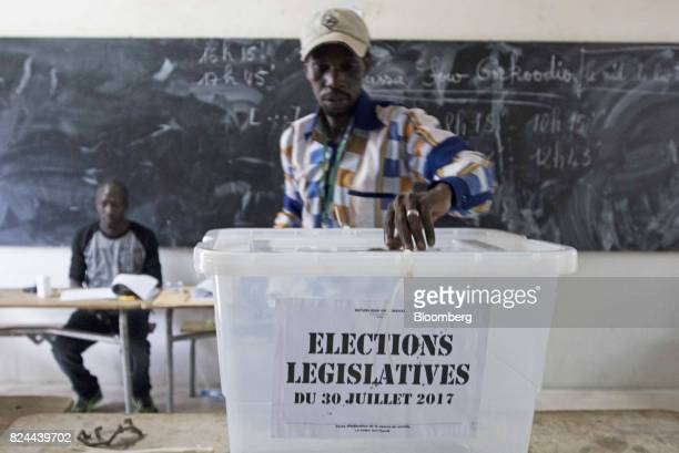 An electoral official prepares a ballot box at a polling station during parliamentary elections in Dakar Senegal on Sunday July 30 2017 Senegalese...