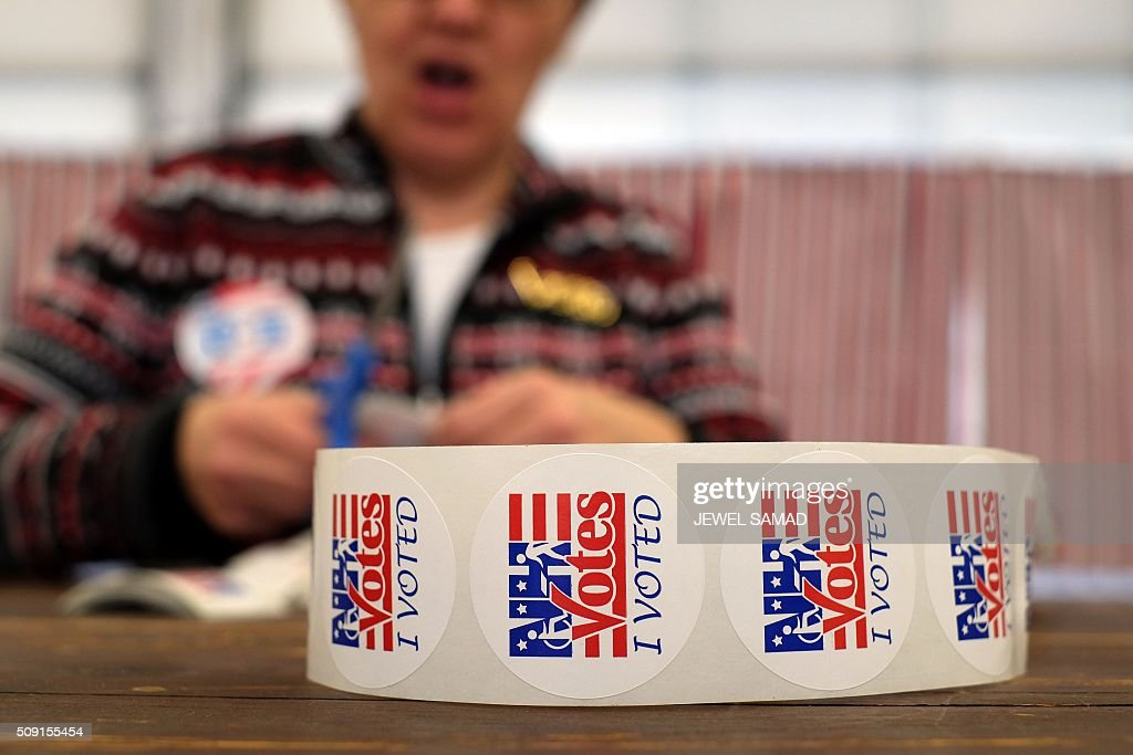 An electoral official prepares 'I Voted' stickers as local residents vote for the first US presidential primary at a fire station in Loudon, New Hampshire, on February 9, 2016. New Hampshire began voting on February 9 in the first US presidential primary with Republican Donald Trump calling on supporters to propel him to victory and Democrat Bernie Sanders primed to upstage Hillary Clinton. The northeastern state, home to just 1.3 million people, sets the tone for the primaries and could shake out a crowded Republican field of candidates pitting Trump and arch-conservative Senator Ted Cruz against more establishment candidates led by Senator Marco Rubio. SAMAD