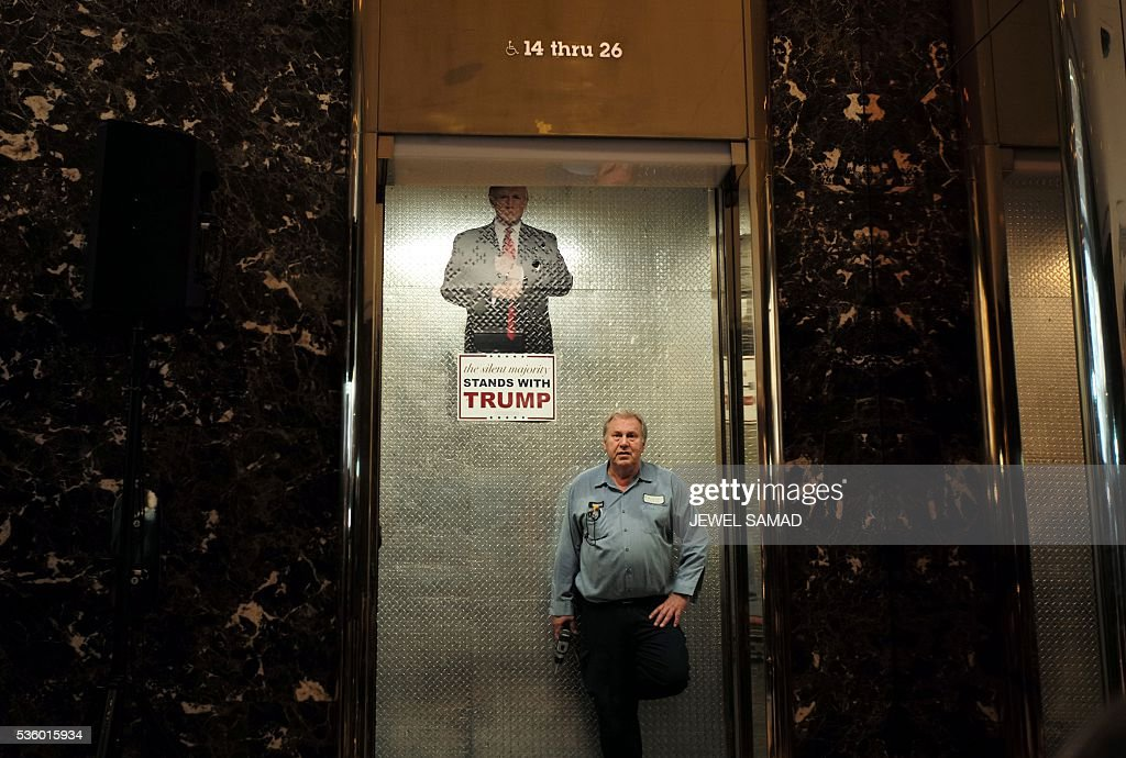 An electoral poster of US Republican presidential candidate Donald Trump is seen pasted in an elevator at the Trump Tower on May 31, 2016 in New York. / AFP / Jewel SAMAD