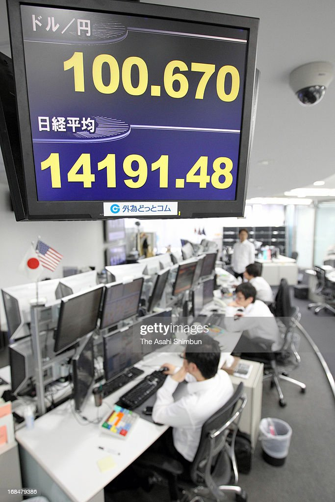 An Electric board displays the exchange rate of Japanese yen against U.S. Dollar and Nikkei 225 stock avarage at Gaitame.com on May 10, 2013 in Tokyo, Japan. Japanese yen plunges below 100 level for the first time in four years.