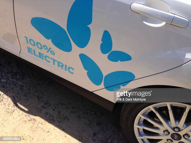 An electric car proclaims the fact