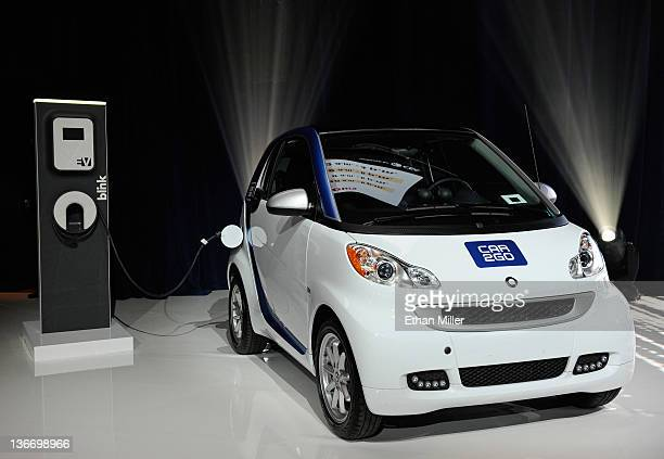 An electric car2go Smart vehicle from the company's carsharing network is displayed before a keynote address by Daimler AG Chairman and head of...