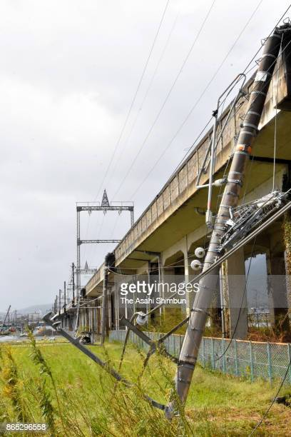An electric pole of JR Kosai Line falls after powerful Typhoon Lan hit past Japan's mainland on October 23 2017 in Otsu Shiga Japan Powerful Typhoon...