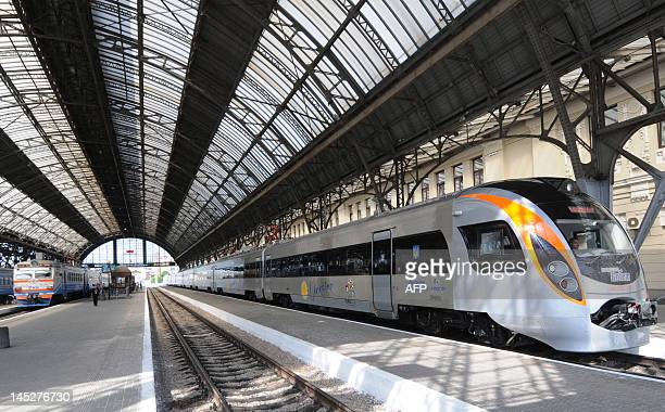 An electric train arrives in the railway station of the western Ukrainian city of Lviv during its first trip from Kiev on May 25 2012 Ukraine bought...