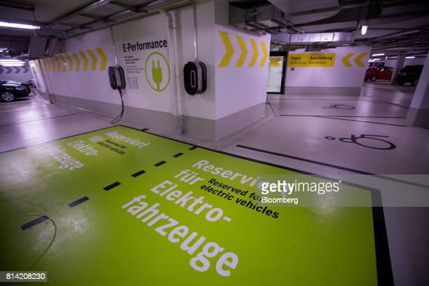 An electric vehicle charging station space sits in an underground parking garage beneath the Porsche Museum in Stuttgart Germany on Thursday July 13...