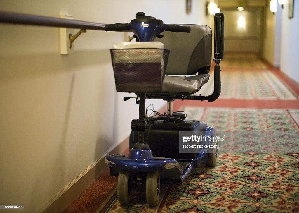 An electric wheelchair is left outside a residence at an assisted living facility November 10, 2012 in Connecticut.