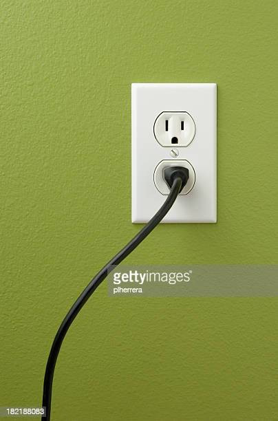 An electrical outlet with a plug inserted