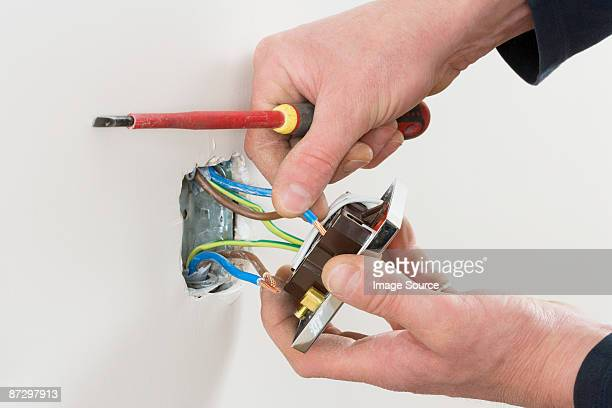 An electrician fixing a socket