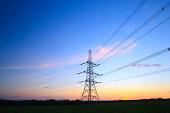 An electricity pylon at sunset