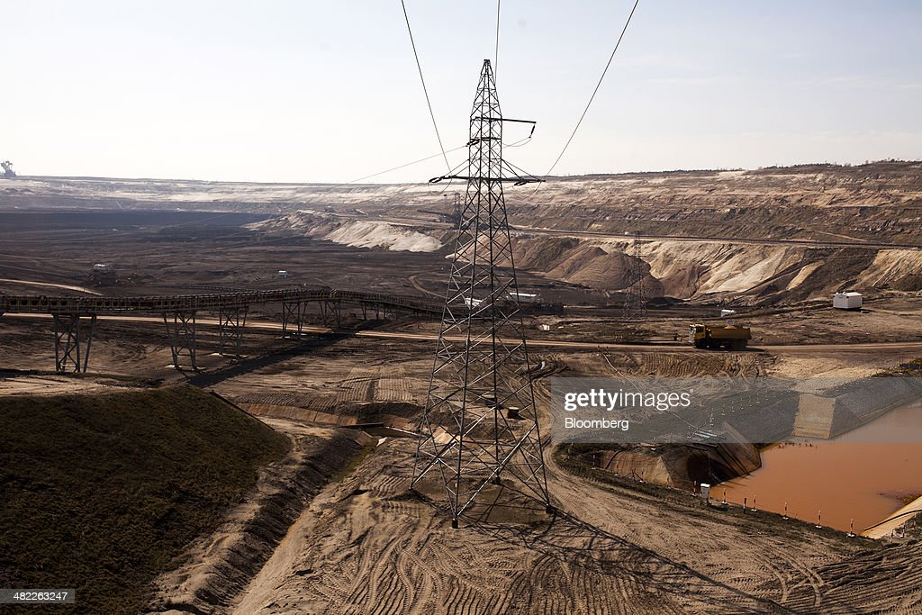 An electricity pylon carries power cables across the digging floor of the lignite, also known as brown coal, open pit mine operated by PGE Elektrownia Belchatow SA near Belchatow, Poland, on Wednesday, April 2, 2014. Polish power prices are set to stay above German contracts through 2015, reversing a historic discount, as the cost of keeping plants open in the eastern European nation is factored in, according to Vattenfall AB. Photographer: Bartek Sadowski/Bloomberg via Getty Images
