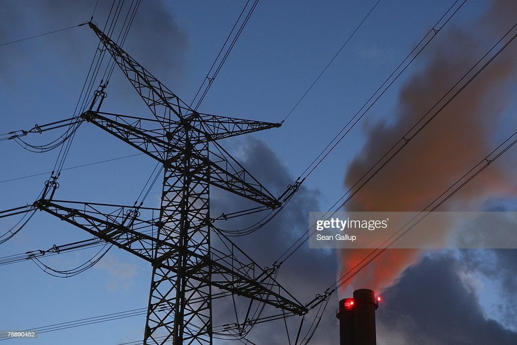 An electricity pylon stands by exhaust pluming from the main chimneys of the coalfired power plant Heizkraftwerk Reuter West July 31 2007 in Berlin...