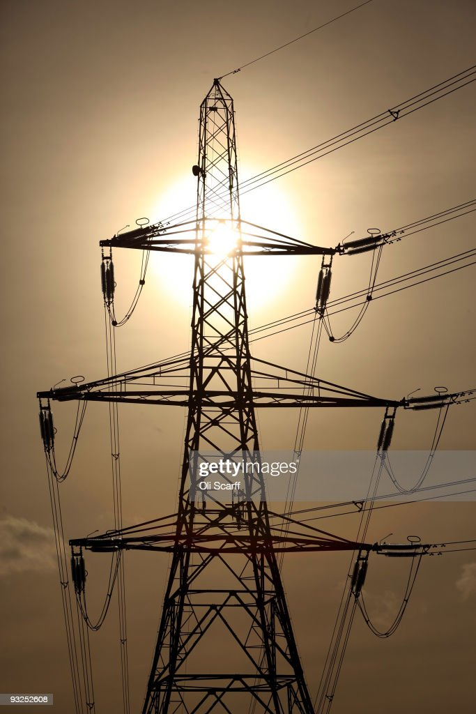An electricity pylon stands in the Essex countryside on November 19, 2009 near Cambridge, United Kingdom. As world leaders prepare to gather for the Copenhagen Climate Summit in December, the resolve of the industrial nations seems to be weakening with President Obama stating that it would be impossible to reach a binding deal at the summit. Climate campaigners are concerned that this disappointing announcement is a backward step ahead of the summit.