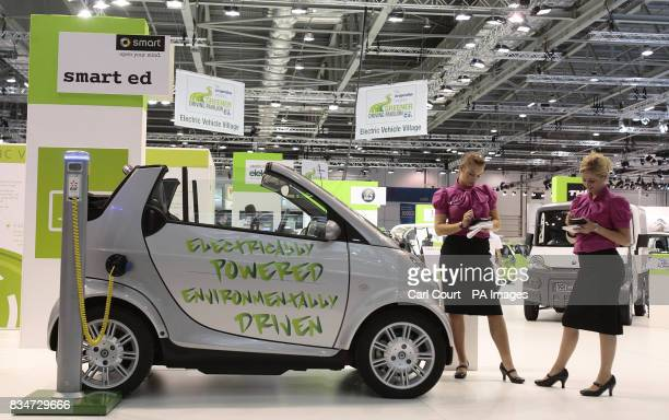 An electricitydriven Smart car on display at the 2008 British International Motor Show at the Excel Centre London is plugged into the new Elektrobay...