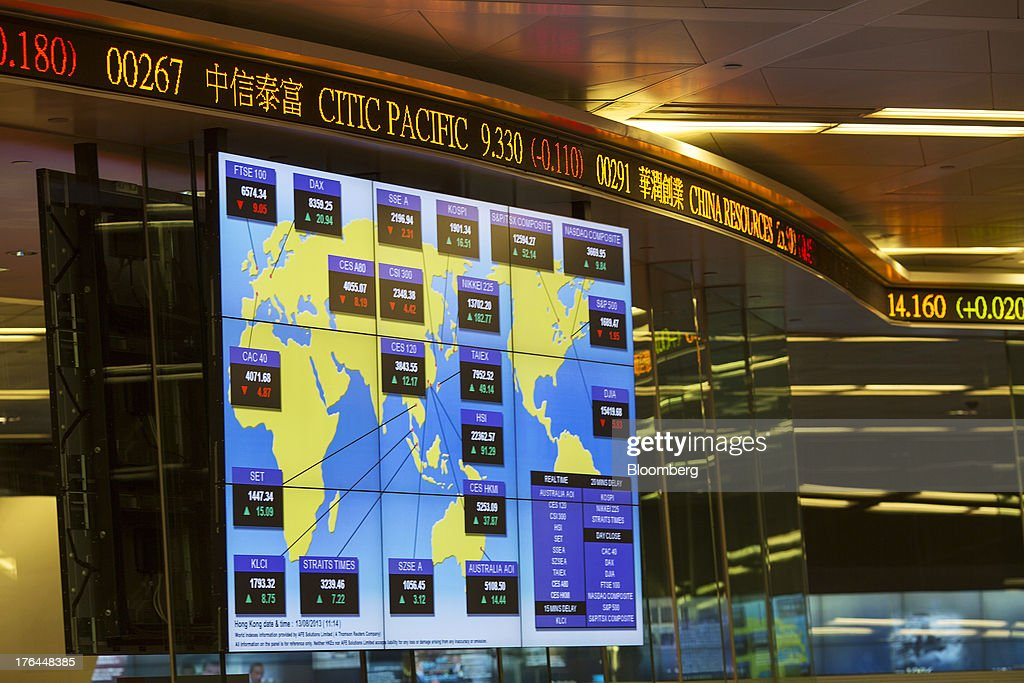 An electronic board displays stock market indices from around the globe on the trading floor of the Hong Kong Stock Exchange in Hong Kong, China, on Tuesday, Aug. 13, 2013. Hong Kong Exchanges & Clearing Ltd., operator of the Hong Kong Stock Exchange, is scheduled to release second-quarter results tomorrow. Photographer: Jerome Favre/Bloomberg via Getty Images